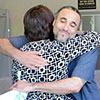 KU Project for Innocence attorney Alice Craig hugs exoneree Richard Jones after his release from prison