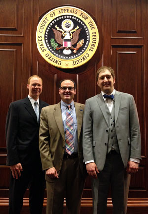 Justin Hendrix, L'09, Dean Stephen Mazza, and Devin Sikes, L'08, at the U.S. Court of Appeals for the Federal Circuit